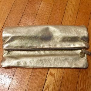 Clare V. metallic gold fold-over clutch
